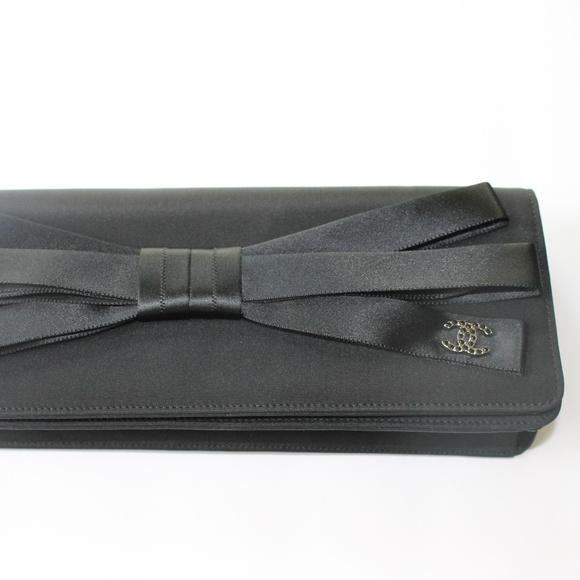 ca94e1e8f933 CHANEL Handbags - CHANEL Black Satin Bow Silver CC Logo Clutch Bag